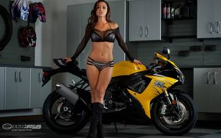 Gorgeous woman near a motorcycle.